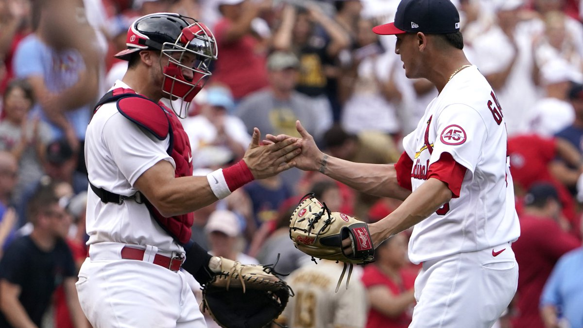 St. Louis Cardinals relief pitcher Giovanny Gallegos and catcher Andrew Knizner celebrate an...