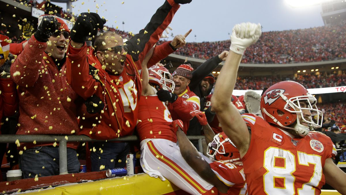 Kansas City Chiefs tight end Travis Kelce (87) celebrates with fans after tight end Blake Bell, center, scored a touchdown against the Houston Texans, during the second half of an NFL divisional playoff football game, in Kansas City, Mo., Sunday, Jan. 12, 2020. (AP Photo/Charlie Riedel)