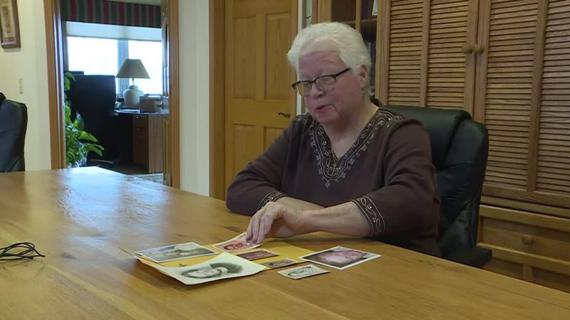 Sandi Schmitt looks over the only photos she has of her brother, Billy.