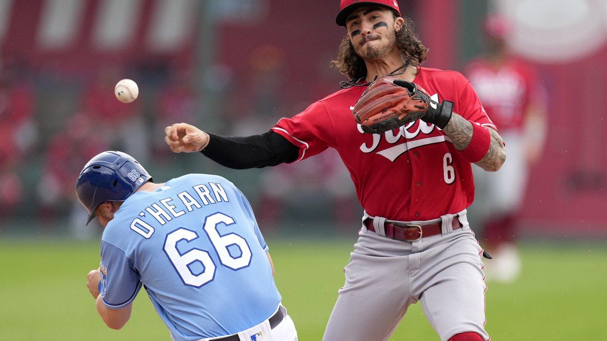 A ball thrown by Cincinnati Reds second baseman Jonathan India bounces off Kansas City Royals'...