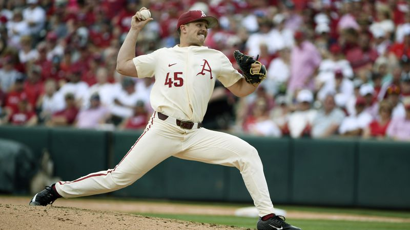FILE - Arkansas pitcher Kevin Kopps throws a pitch against Mississippi during the sixth inning...