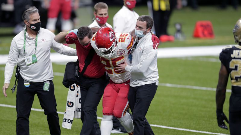 Kansas City Chiefs running back Clyde Edwards-Helaire (25) is helped off the field after being...