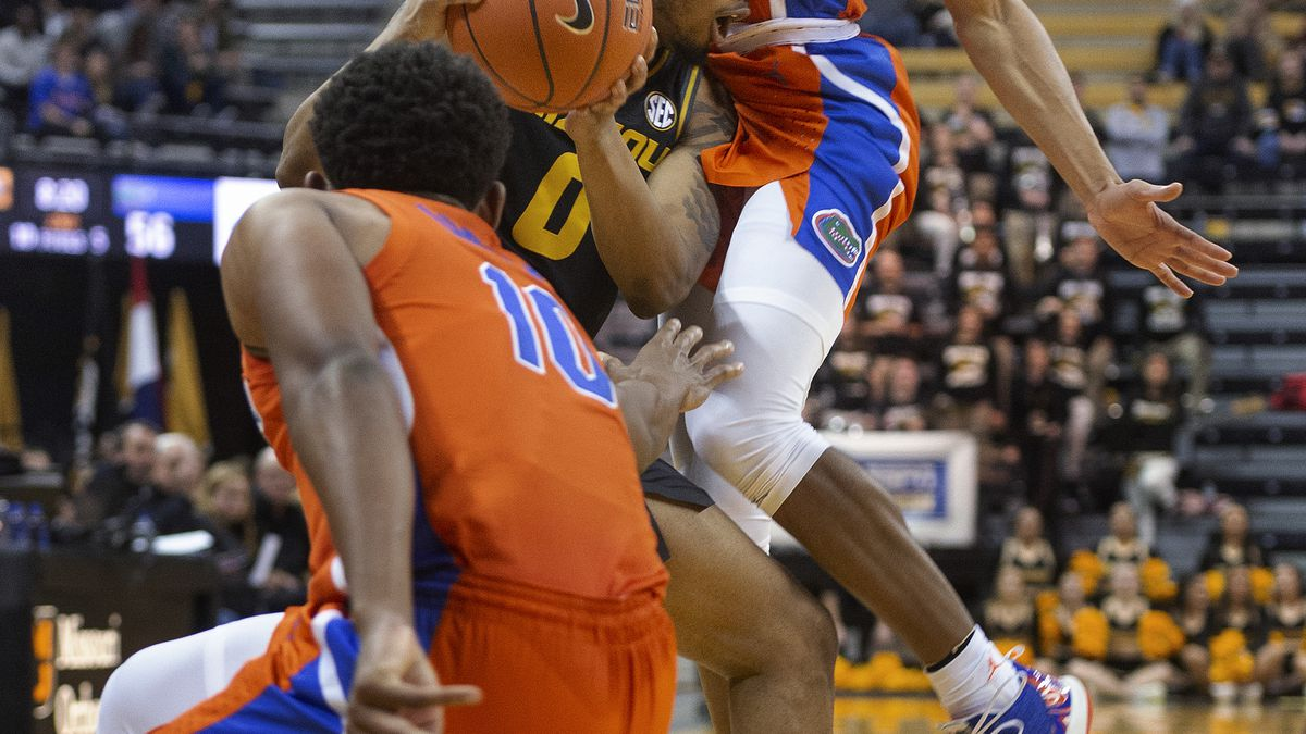 Missouri's Torrence Watson, center, looks to pass between Florida's Tre Mann, top, and Noah Locke, bottom, during the second half of an NCAA college basketball game Saturday, Jan. 11, 2020, in Columbia, Mo. Missouri won 91-75. (AP Photo/L.G. Patterson)