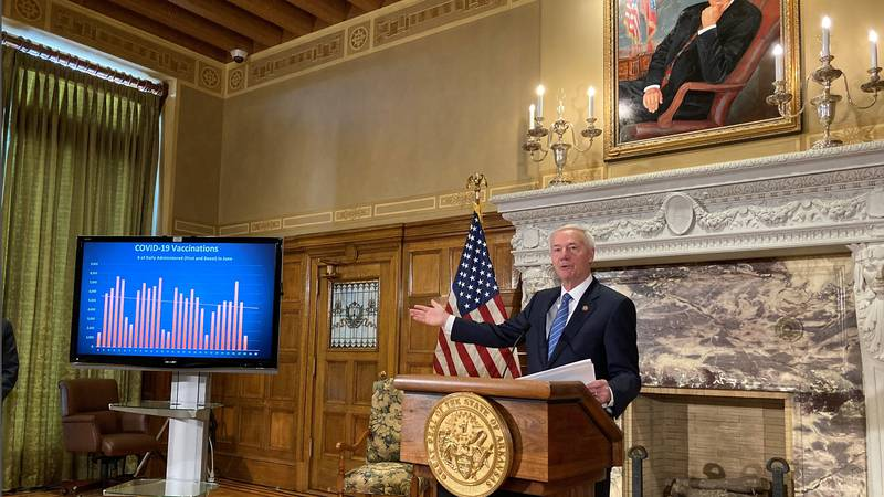 Arkansas Gov. Asa Hutchinson talks about COVID-19 vaccinations at the state Capitol in Little...