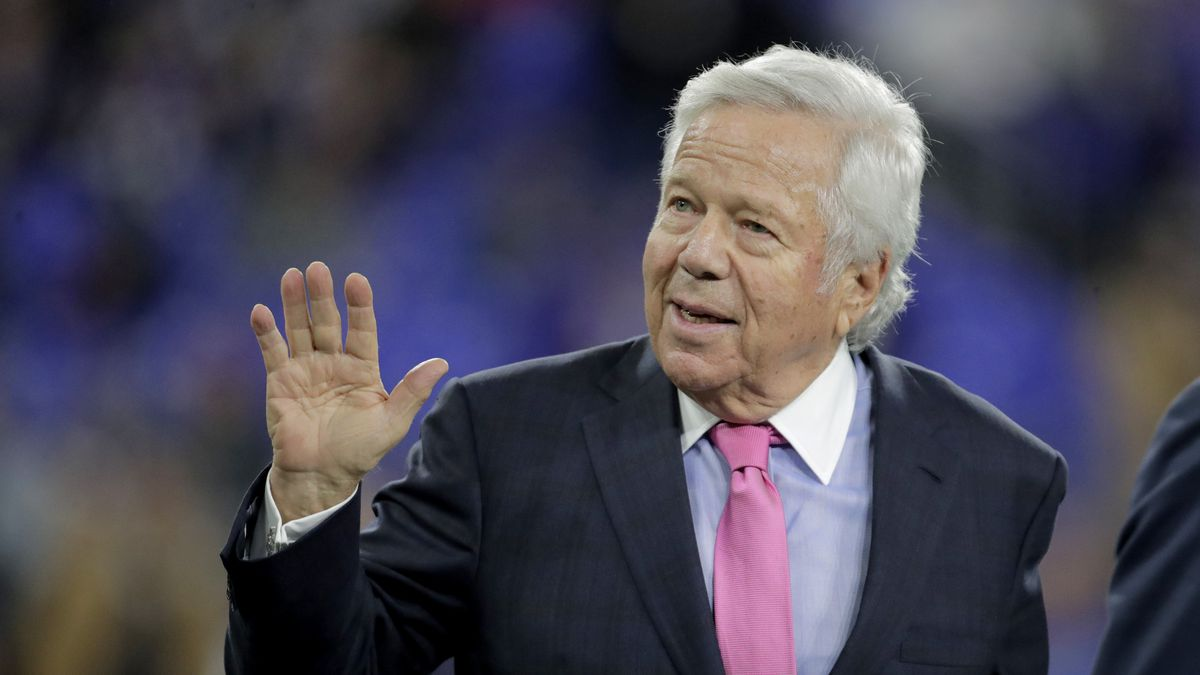 FILE - In this Nov. 3, 2019, file photo, New England Patriots owner Robert Kraft waves to fans as he walks on the field prior to the team's NFL football game against the Baltimore Ravens in Baltimore. Florida prosecutors will try to save their prostitution solicitation case against Kraft when they argue before an appellate court Tuesday, June 30, 2020, that his rights weren't violated when police secretly video recorded him allegedly paying for sex at a massage parlor. (AP Photo/Julio Cortez, File)