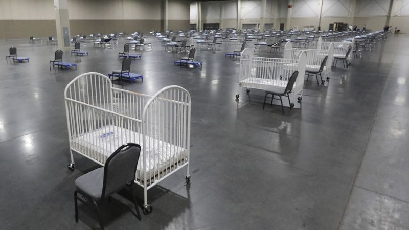 FILE - In this Monday, April 6, 2020 file photo, cots and cribs are arranged at the Mountain...