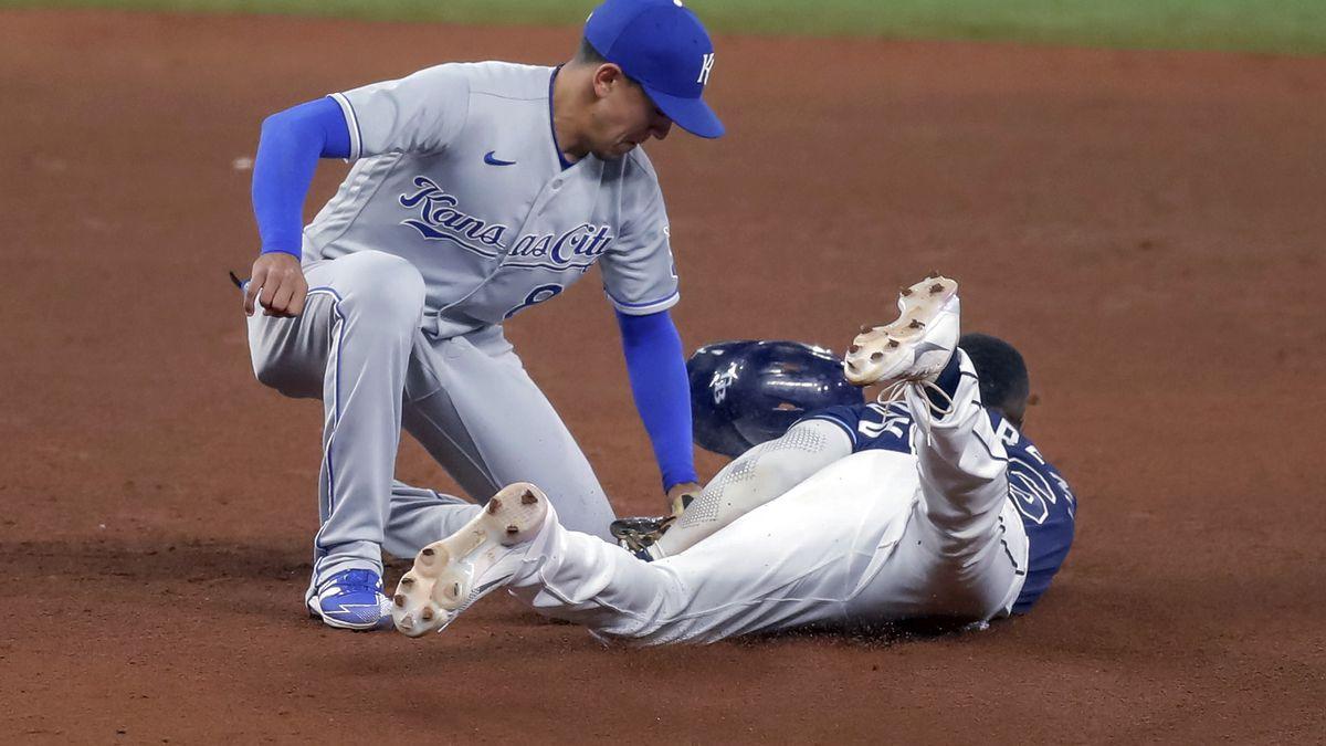Kansas City Royals second baseman Nicky Lopez tags out Tampa Bay Rays' Randy Arozarena on an...