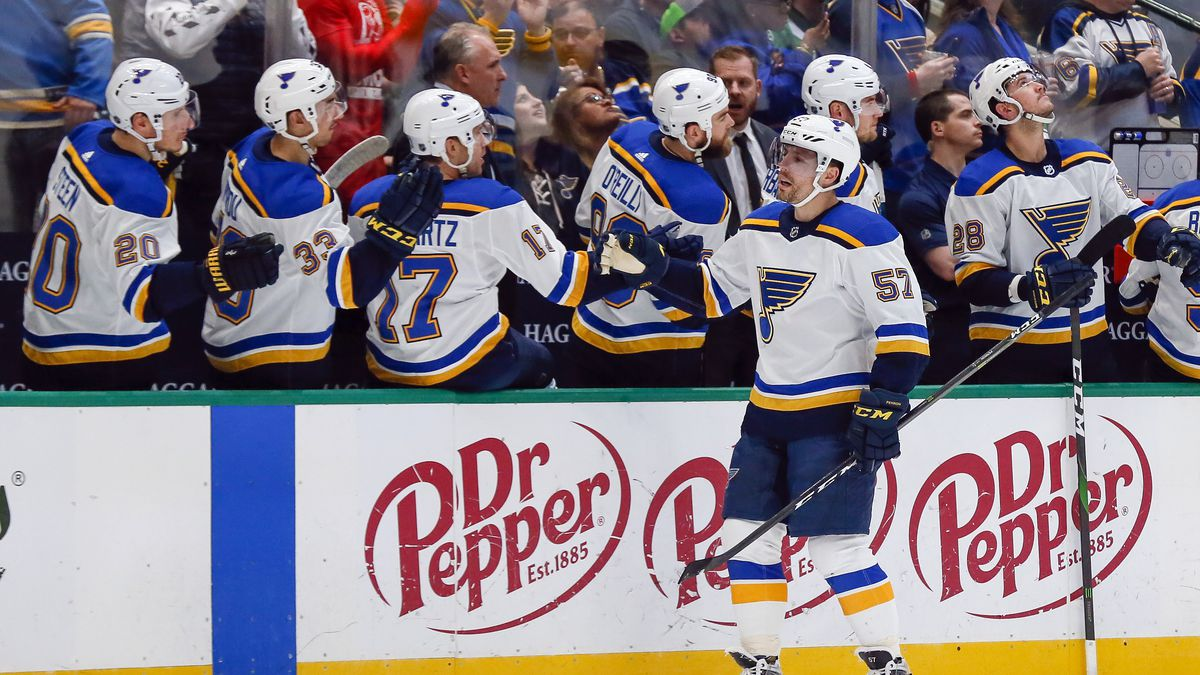 St. Louis Blues left wing David Perron (57) is congratulated by teammates on the bench after...