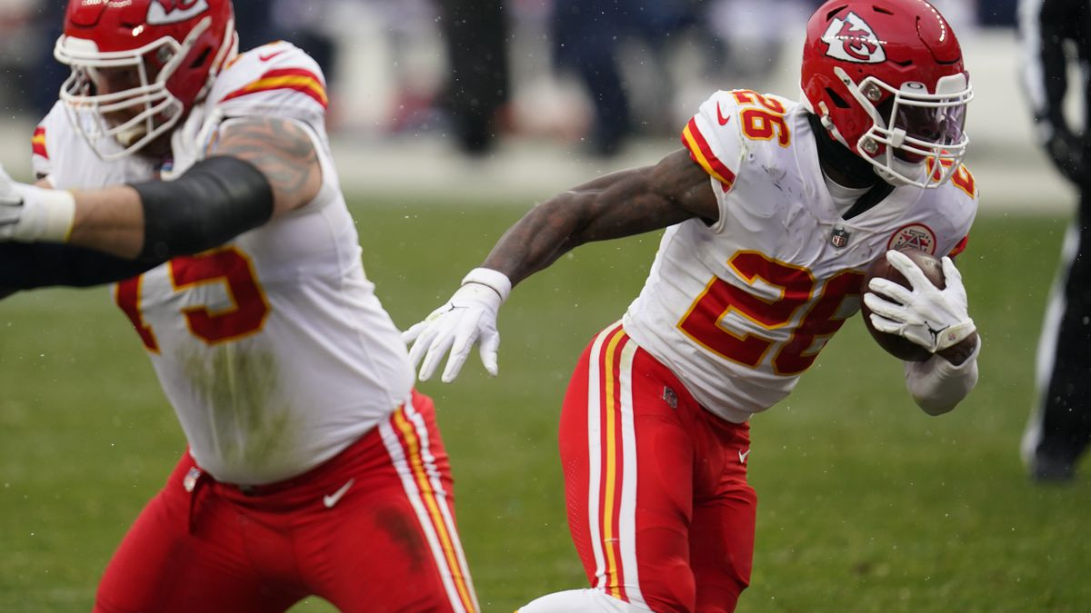 Kansas City Chiefs running back Le'Veon Bell, right, runs with the ball during the second half...