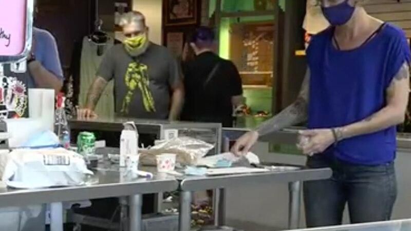 Customers wear mask inside Springfield store.