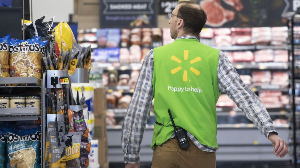 FILE - In this April 24, 2019, file photo a Walmart associate works at a Walmart Neighborhood Market in Levittown, N.Y. Walmart Inc. reports financial results Thursday, Aug. 15. (AP Photo/Mark Lennihan, File)
