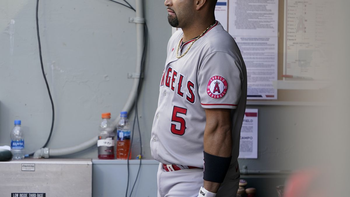 Los Angeles Angels Albert Pujols leans on his bat in the dugout during the eighth inning of a...