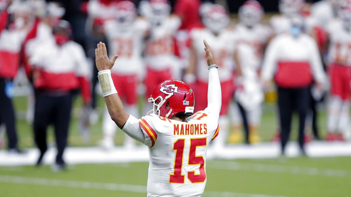 Kansas City Chiefs quarterback Patrick Mahomes (15) reacts after a touchdown by running back...