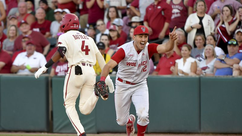 North Carolina State first baseman Austin Murr (12) reacts after making the game ending out on...