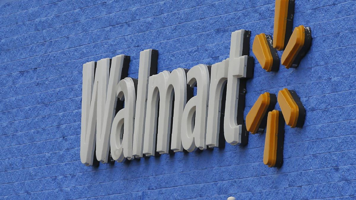 Signage is pictured at a Walmart store Tuesday, Aug. 4, 2020, in Oklahoma City. Walmart delivered strong profits and sales that beat Wall Street expectations for its fiscal second quarter helped by shoppers focused on buying food and other items as they stay close to home during the pandemic. (AP Photo/Sue Ogrocki)