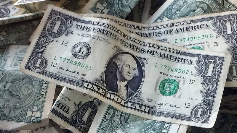 FILE - This Oct. 24, 2016, file photo shows dollar bills in New York. A survey by Fidelity...