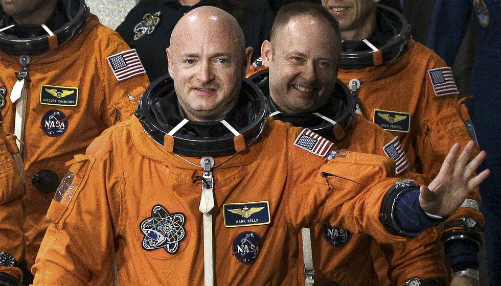 FILE - In this May 16, 2011 file photo, former NASA astronaut and STS-134 commander Mark Kelly,...
