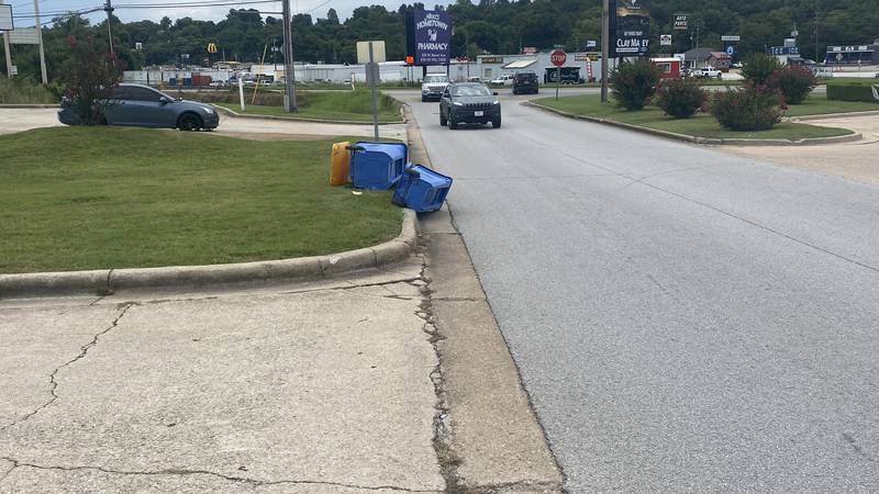 A new ordinance would require people to pull their trash bins away from the curb around pickup...