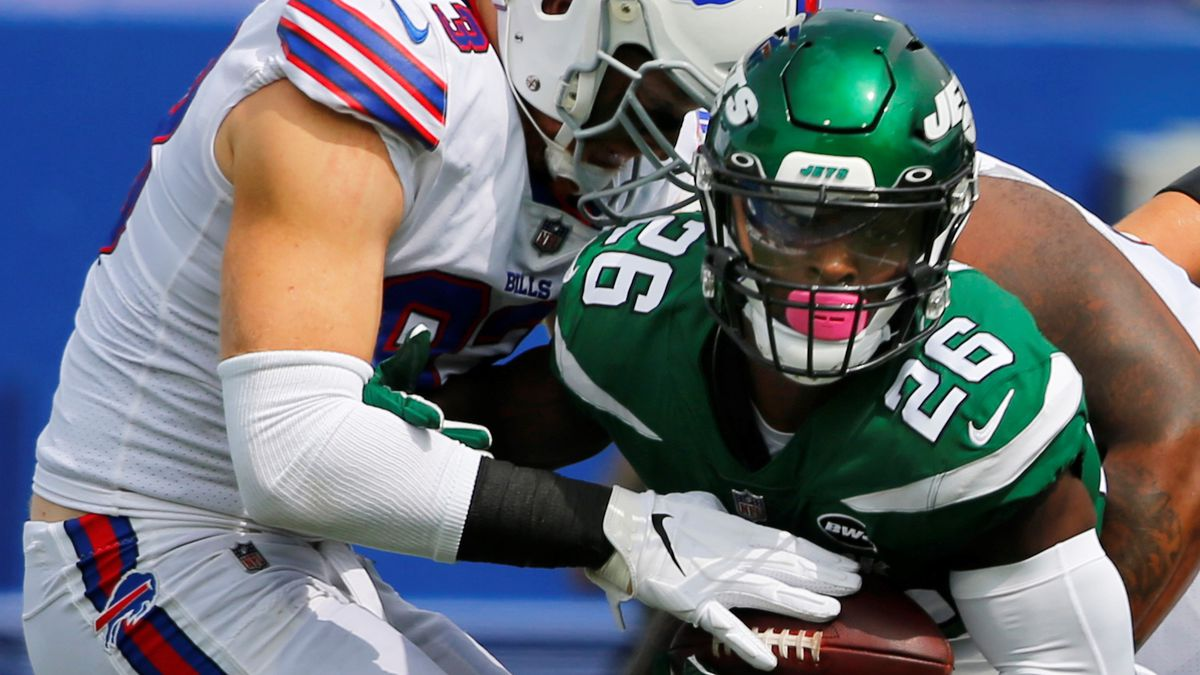 File-This Sept. 13, 2020 file photo shows Buffalo Bills Trent Murphy (93) tackling New York Jets Le'Veon Bell (26) during the first half of an NFL football game in Orchard park, N.Y.  The New York Jets have surprisingly released Bell, ending a disappointing tenure after less than two full seasons. The team issued a statement from general manager Joe Douglas on Tuesday, Oct. 13, 2020, in which he says the Jets made the move after having several conversations with Bell and his agent during the last few days and exploring trade options.  (AP/ Photo Jeffrey T. Barnes, File)