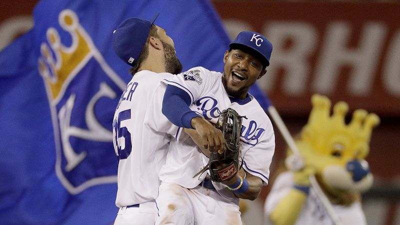 Kansas City Royals' Jarrod Dyson, right, and Eric Hosmer celebrate after their baseball game...
