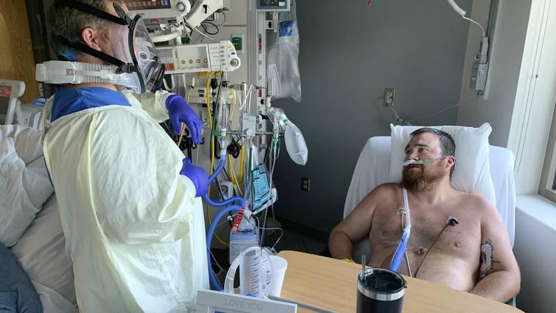 Registered Nurse Chris Murphy walks 31-year-old Daryl Barker through breathing techniques...