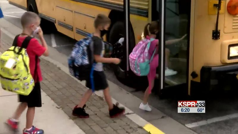 Kids board a school bus