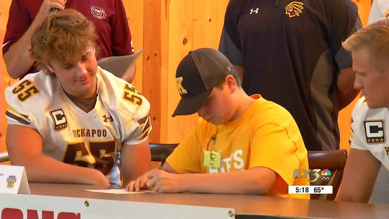 Ethan Clifford signs his letter of intent to manage the Kickapoo Chiefs football team.