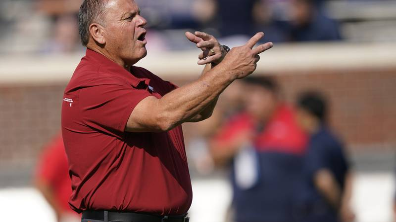 Arkansas head coach Sam Pittman gestures to his players as they warmup prior to their NCAA...
