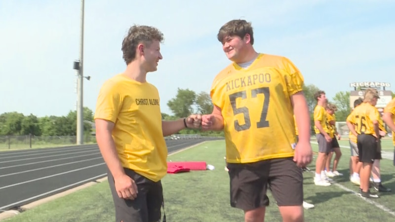 Cross Kubik, a two time cancer survivor, leads Kickapoo High School onto the football field for...