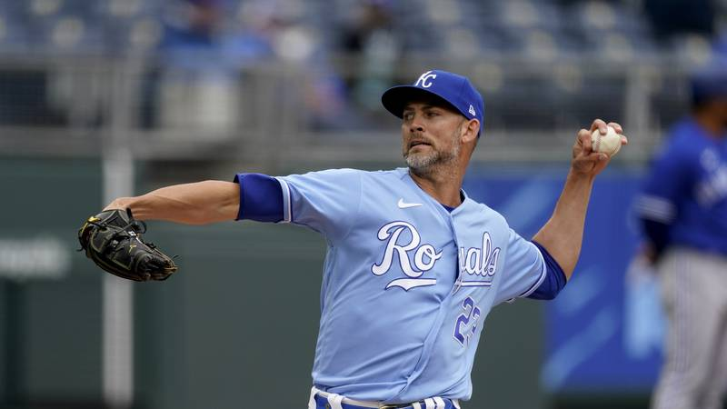 Kansas City Royals starting pitcher Mike Minor throws during the first inning of the first game...