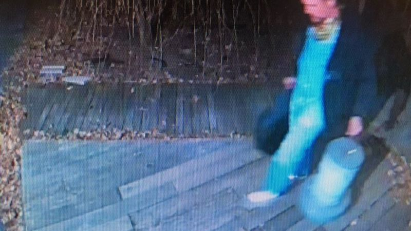 A neighbor's security camera captured the man stealing items on January 10.
