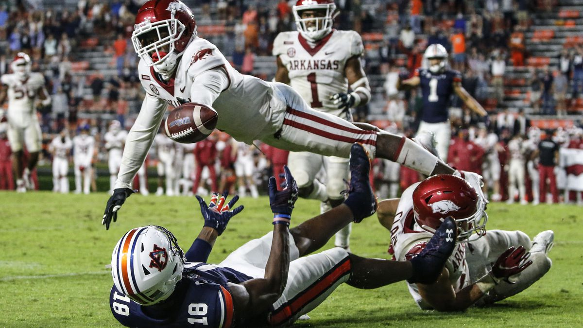 Arkansas defensive back Hudson Clark breaks up a pass intended for Auburn wide receiver Seth...