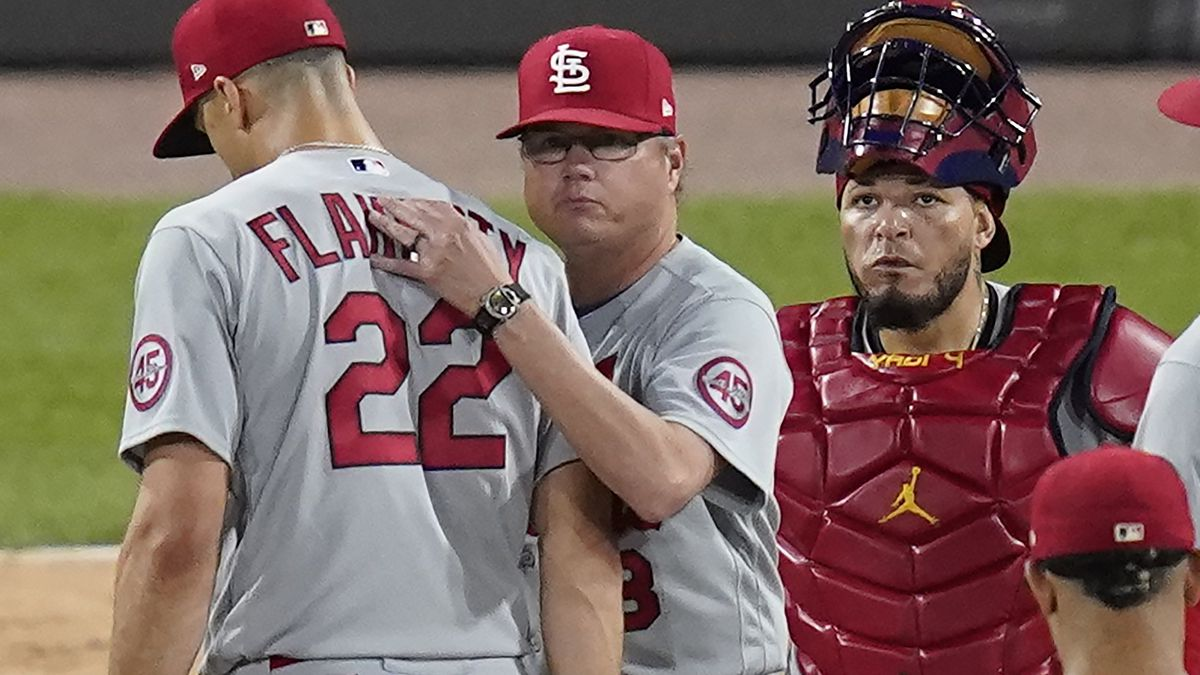 St. Louis Cardinals manager Mike Shildt, center, pats starting pitcher Jack Flaherty (22) on...