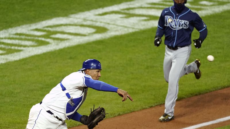 Kansas City Royals catcher Salvador Perez, left, throws to first for a double play hit into by...