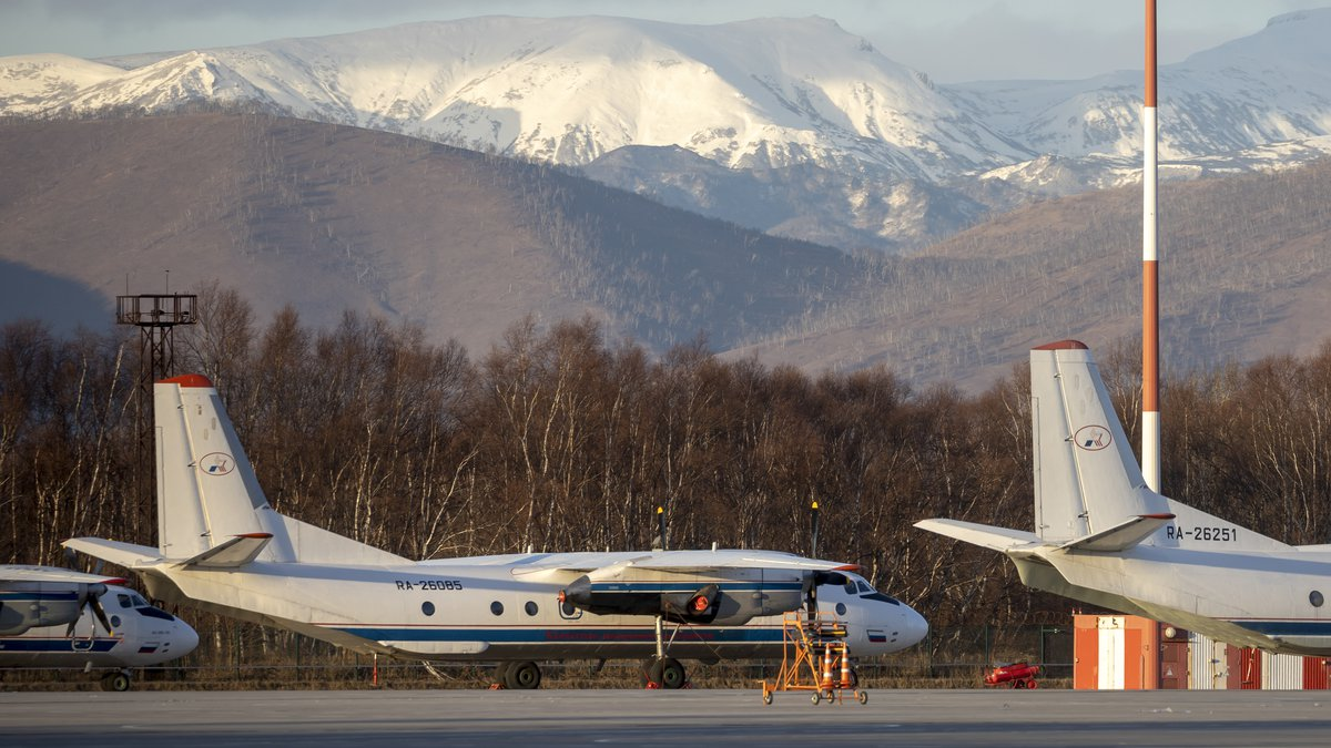 The Antonov An-26 with the same board number #RA-26085 as the missed plane is parked at Airport...