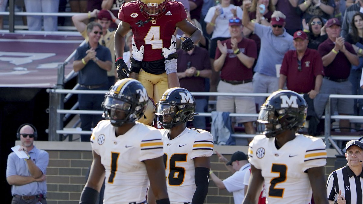 Boston College wide receiver Zay Flowers (4) is lifted by teammates after scoring a touchdown...