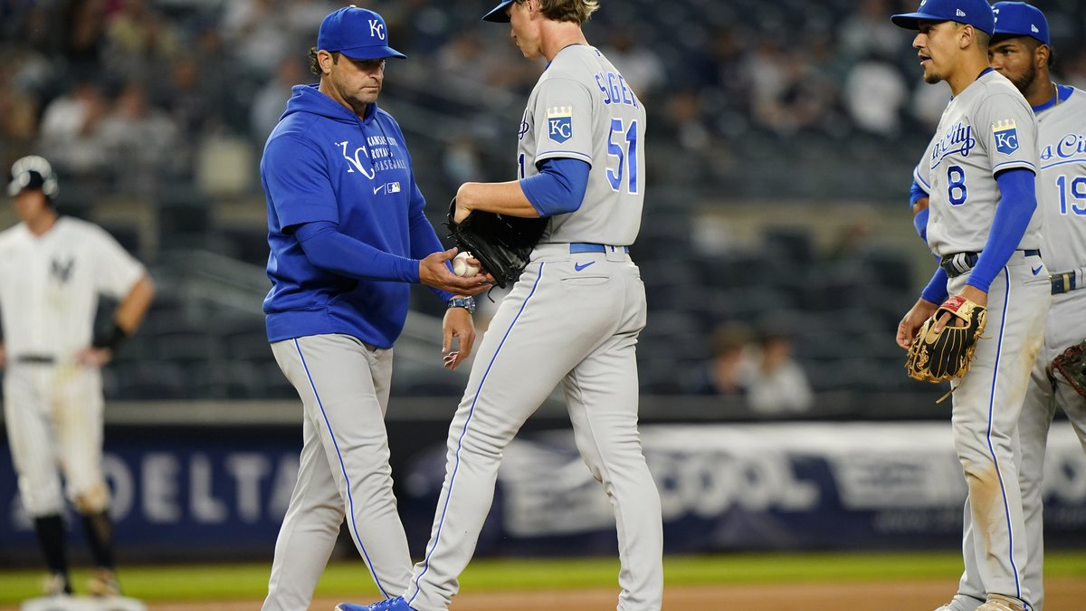 Kansas City Royals manager Mike Matheny takes the ball from Royals starting pitcher Brady...