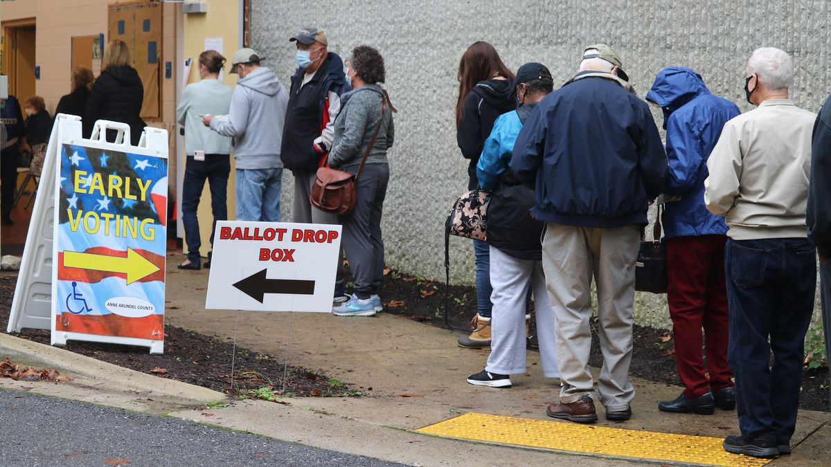FILE - In this Monday, Oct. 26, 2020, file photo, voters wait in line to enter the Pip Moyer...