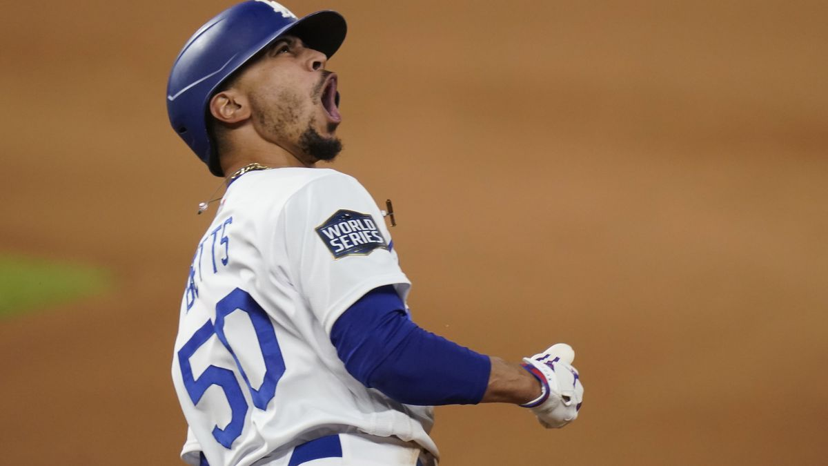 Los Angeles Dodgers' Mookie Betts celebrates after a home run against the Tampa Bay Rays during...