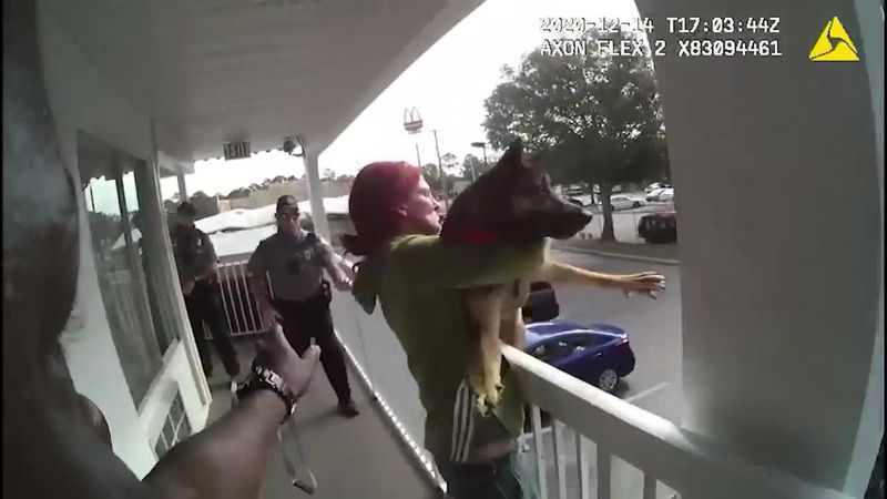 Bodycamera footage shows a woman throwing a dog off a balcony.
