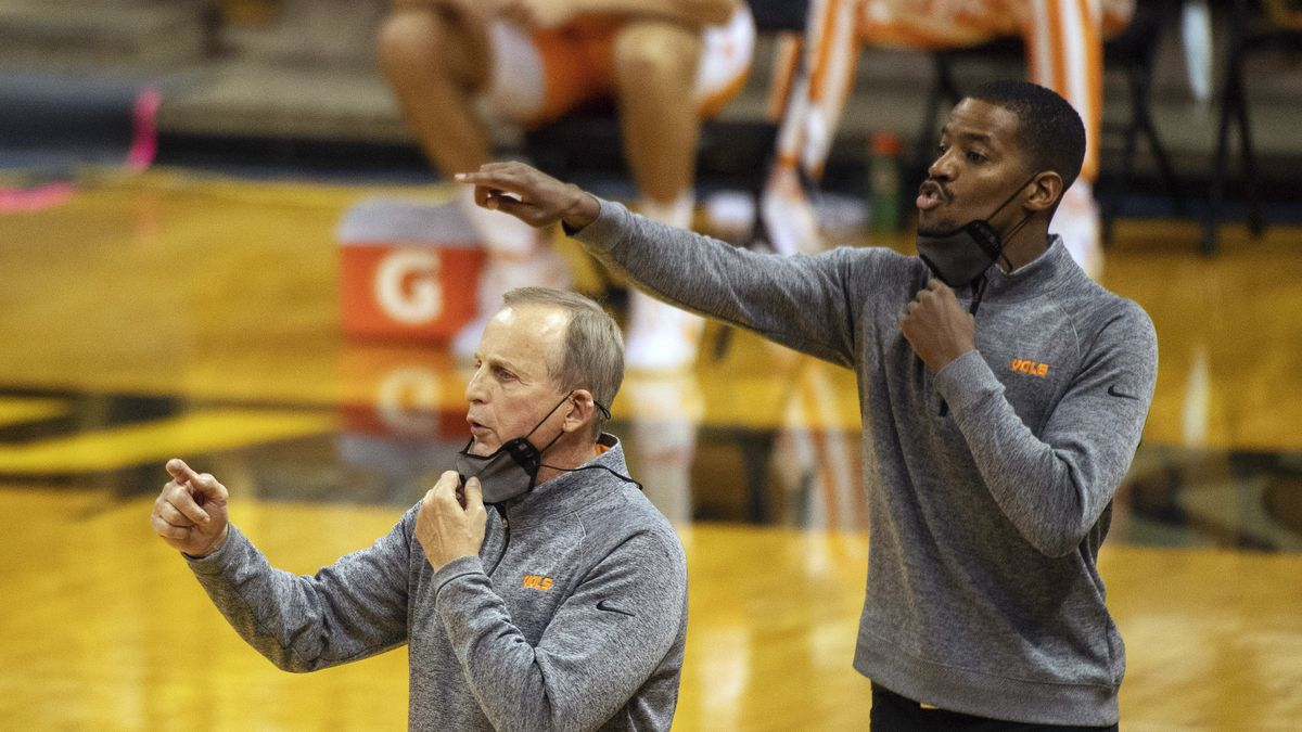 FILE - Tennessee head coach Rick Barnes, left, and assistant coach Kim English, right, position...