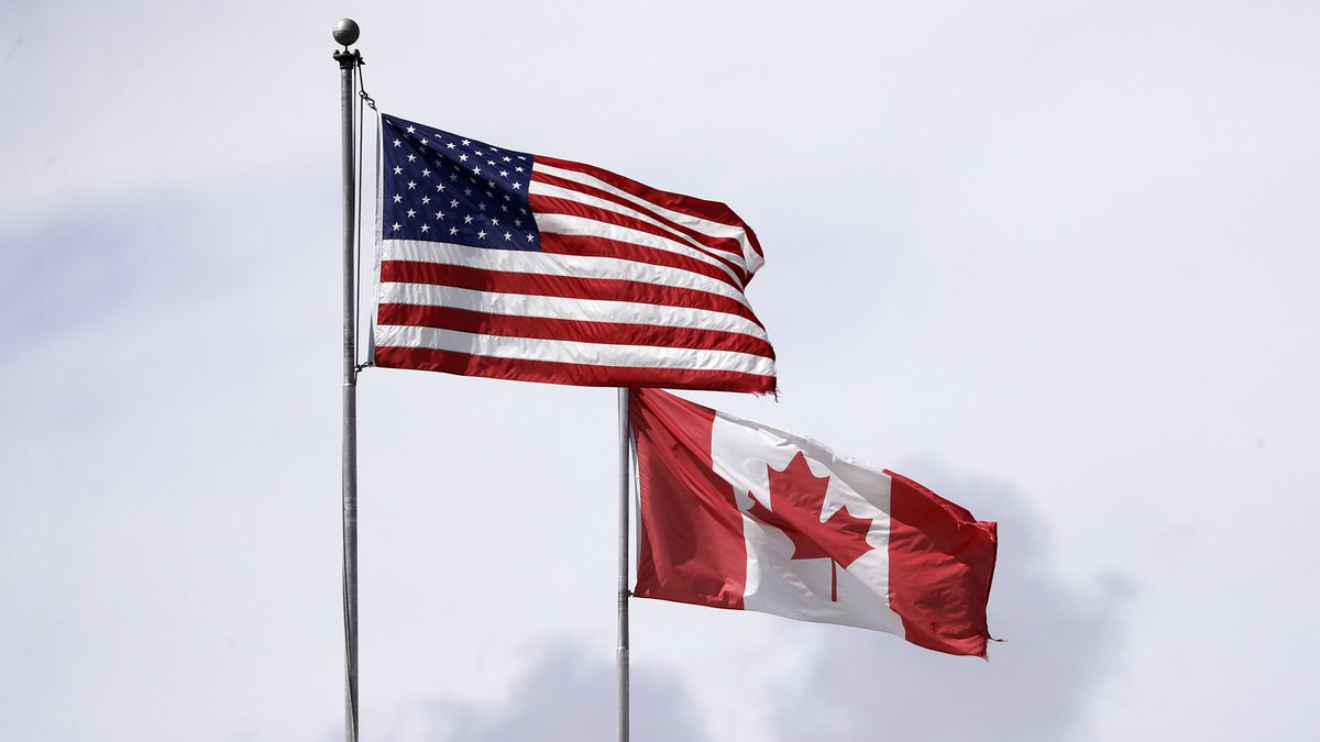 In this photo taken Sunday, May 17, 2020, U.S. and Canadian flags fly atop the Peace Arch at...