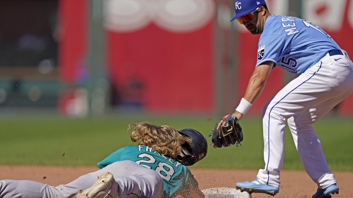 Seattle Mariners' Jake Fraley (28) is forced out at second by Kansas City Royals second baseman...