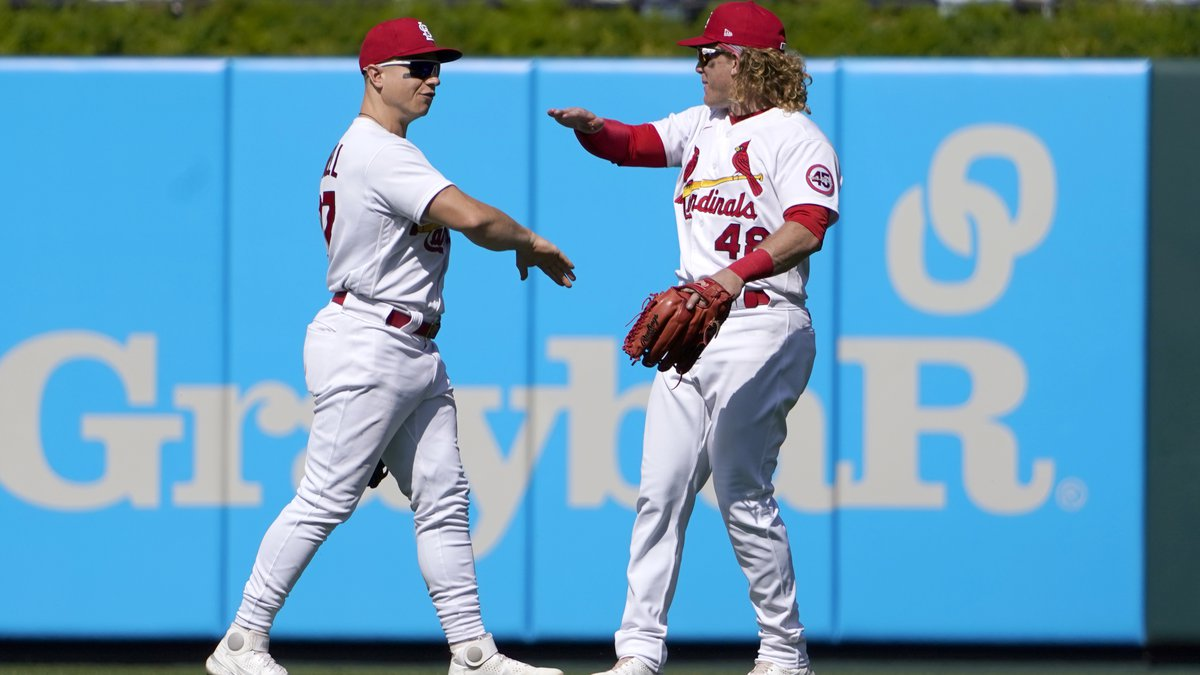 St. Louis Cardinals' Tyler O'Neill, left, and teammate Harrison Bader celebrate a 2-1 victory...