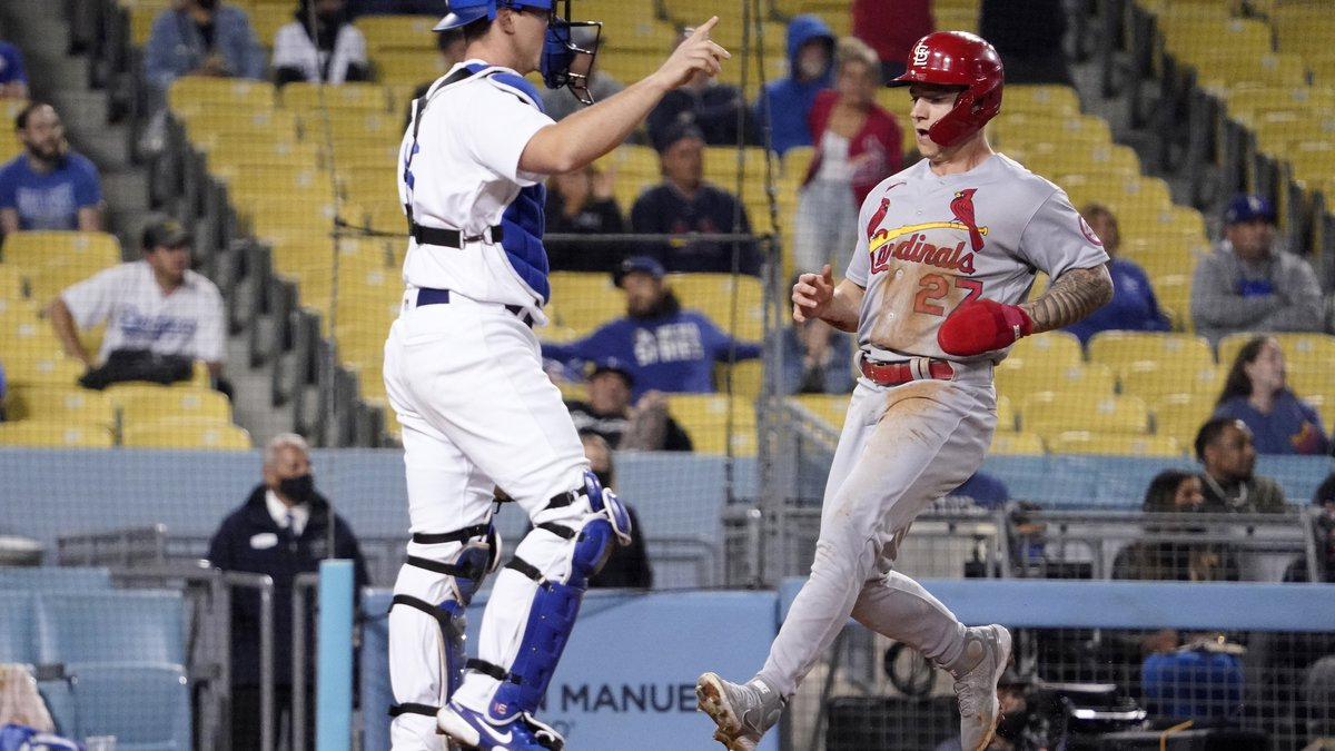 St. Louis Cardinals' Tyler O'Neill, right, scores on a single by Edmundo Sosa as Los Angeles...