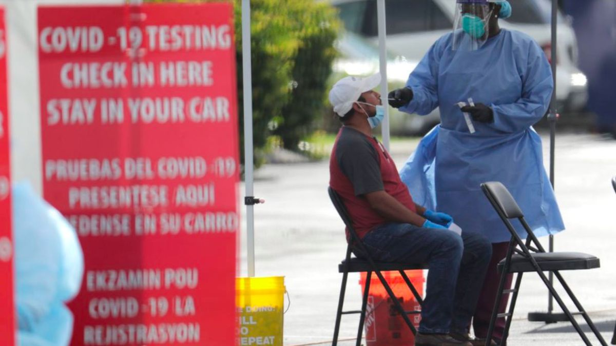 A health care worker administers a COVID-19 test at a site sponsored by Community Heath of South Florida at the Martin Luther King, Jr. Clinica Campesina Health Center, during the coronavirus pandemic, Monday, July 6, 2020, in Homestead, Fla.(AP Photo/Lynne Sladky) (WCAX)