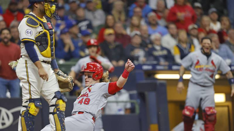 St. Louis Cardinals' Harrison Bader scores from second base on Cardinals' Tommy Edman fly out...