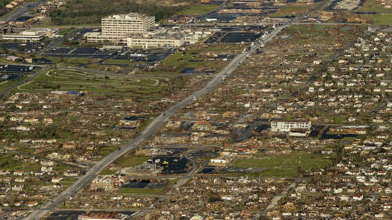 FILE - This May 24, 2011 file photo shows the path of a powerful tornado through Joplin, Mo....