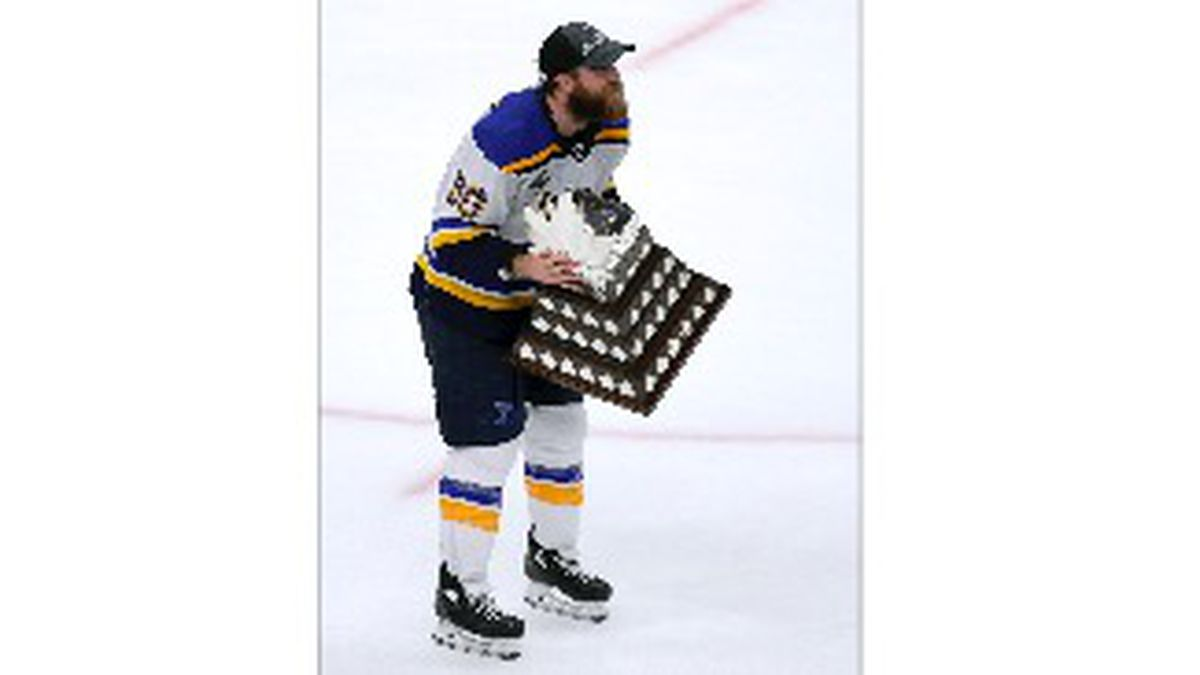 St. Louis Blues' Ryan O'Reilly skates with the Conn Smythe trophy after the Blues' win over the Boston Bruins in Game 7 of the NHL hockey Stanley Cup Final, Wednesday, June 12, 2019, in Boston. (AP Photo/Michael Dwyer)