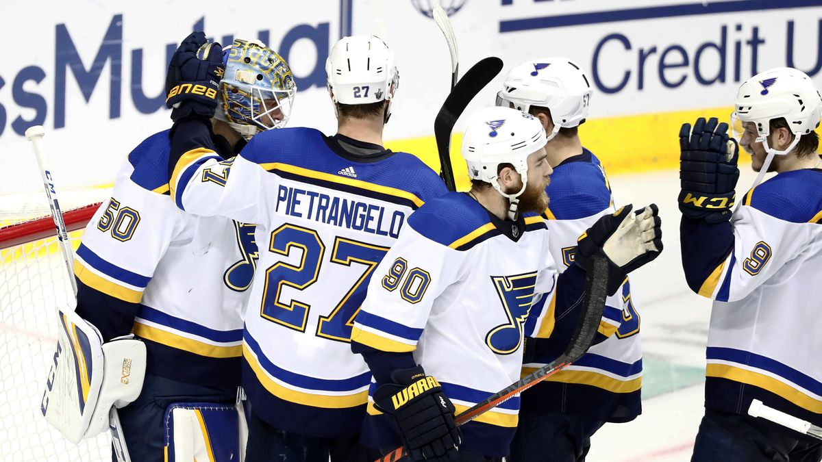 St. Louis Blues goaltender Jordan Binnington (50) celebrates with Alex Pietrangelo (27), Ryan O'Reilly (90), David Perron, center rear, and Sammy Blais (9), following the team's 4-1 win against the Dallas Stars in Game 6 of an NHL second-round hockey playoff series in Dallas, Sunday, May 5, 2019. (AP Photo/Tony Gutierrez)